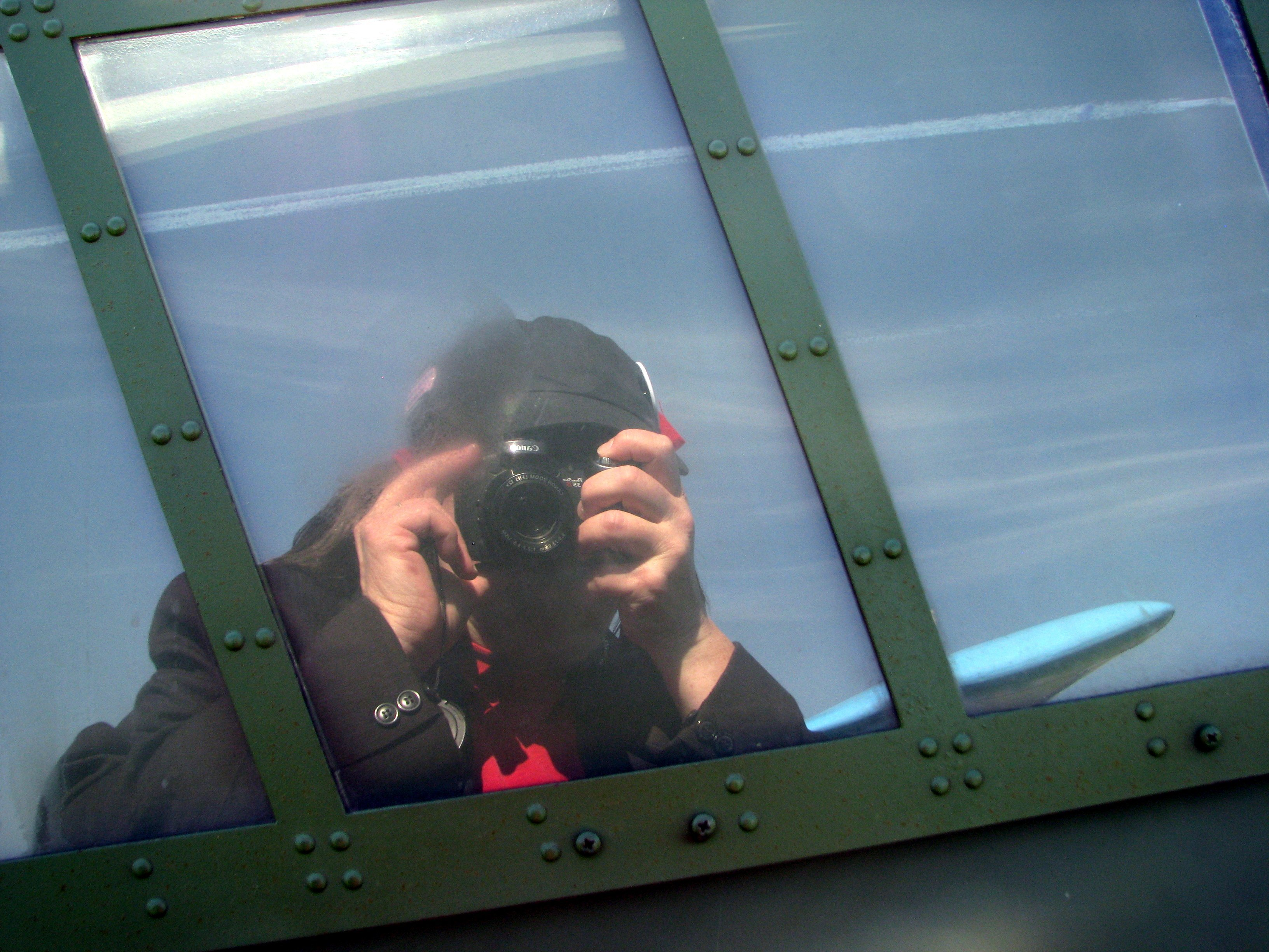 Catching my reflection in a warplane canopy at the Tiger Boys Fly-In